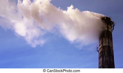 Chimney smoke in the background of blue sky