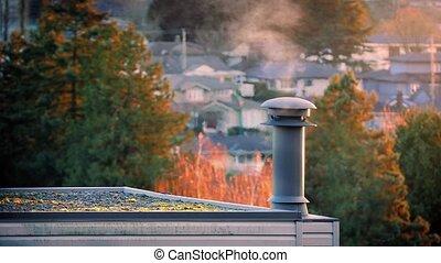 Chimney Smoking On Peaceful Evening - Smoke drifting from...