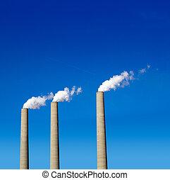 Chimney white smoke three in a row on a blue sky