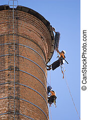 Chimney Workers - Cropped shot of two unrecognizable workers...
