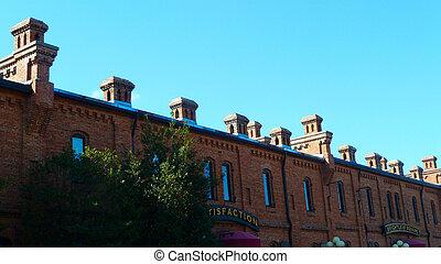 Chimneys against a blue sky