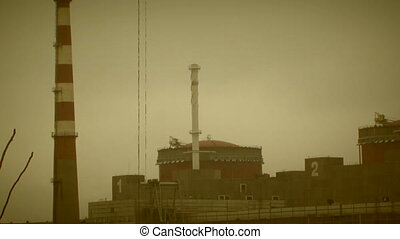 Chimneys of a nuclear power station - An industrial view of...