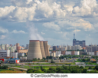Chimneys of a power plant, an industrial district in the North of Moscow. Aerial view