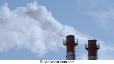 Chimneys of Power Plant at blue sky