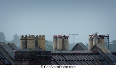 Chimneys On Rooftops In Heavy Rain - Chimneys on roofs of...