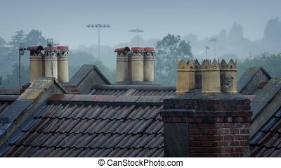 Chimneys On Rooftops In The Rain - Chimneys on roofs of...
