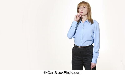 chin stroking. decision and skepticism. girl in pants and...