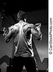 Chin up in the gym black and white