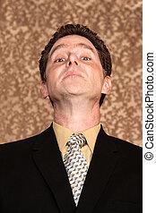 Chin up - Proud or arrogant businessman on paisley...