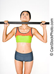 Chin up - Young attractive asian women in gym gear working...
