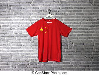 China flag on shirt and hanging on the wall with brick pattern wallpaper.