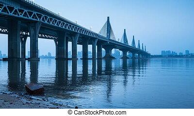 China Haikou Century Bridge Night - City skyline and sea...