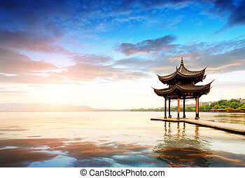 ancient pavilion in hangzhou with sunset glow, China