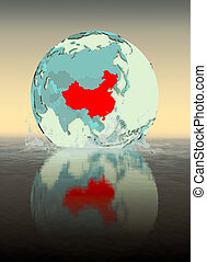 China on globe splashing in water