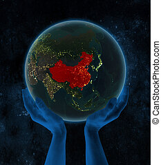 China on night Earth in hands in space