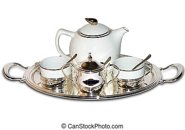 China set with silver inserts and tea tray. Isolated over white
