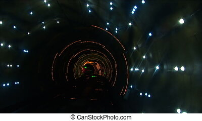 The Bund sightseeing tunnel goes under the Huangpu River, slow shutter speed