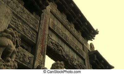 China stone arch & ancient eaves.Majestic looking up angle.