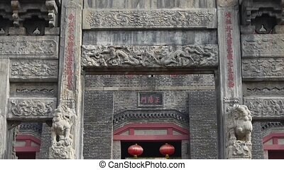 China stone arch & stone lions in front of ancient city gate.