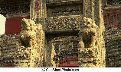 China stone arch & stone lions in front of ancient city...