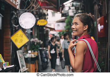 China travel Asian tourist chinese woman walking in shopping market street food alley of Tianzifang, French concession, Shanghai, China Asia summer tourism vacation.