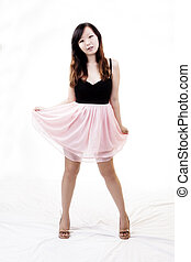 Chinese American Woman Standing In Black And Pink Dress