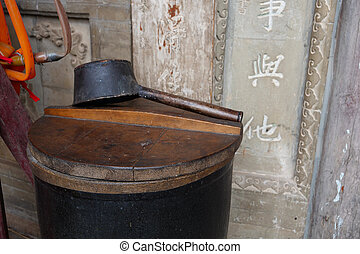 Chinese ancient traditional vat and ladle in front of a temple in Tianshui Wushan, Gansu China