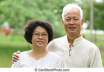 Chinese Asian senior couple at outdoor