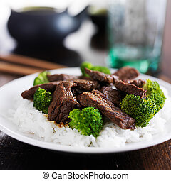 chinese beef and broccoli stir fry on rice