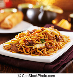 chinese beef lo mein on plate