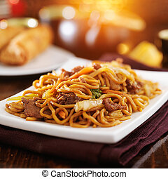 chinese beef lo mein with orange lens flare