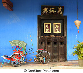 Chinese blue house door with rickshaw