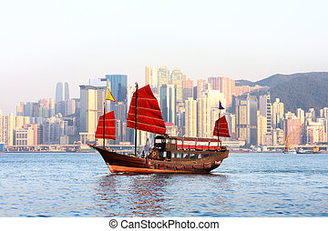 chinese boat - Hong Kong harbour with tourist junk at sunset...