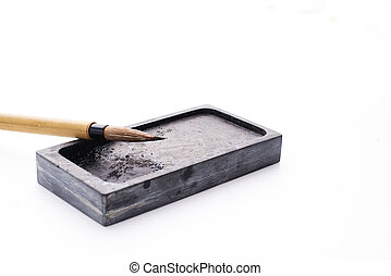 Chinese brushes and ink stone writing instrument on white papers