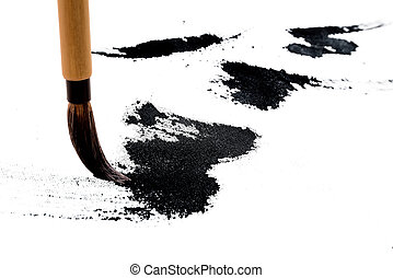 Chinese brushes draw on white paper