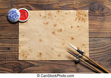 chinese brushes on wooden board
