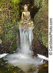 chinese buddha sculpture sitting in flowing water cascade