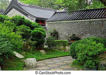 chinese building in green forest