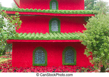 Chinese building model made of flowers