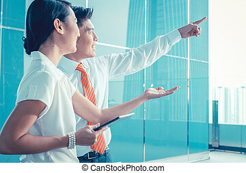 Chinese business man explaining his vision or idea to colleague