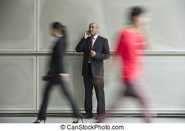 Chinese Business man using a Cell Phone.