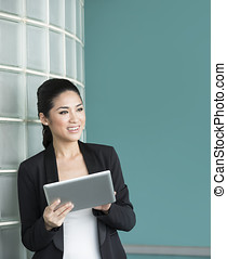 Chinese business woman holding a tablet computer.