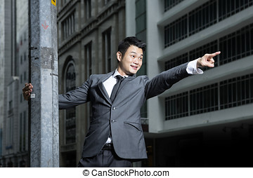 Chinese Businessman pointing to the future.