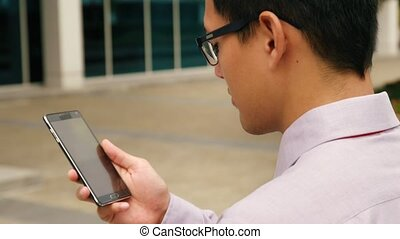 Chinese Businessman Typing Message On Smartphone Mobile Phone