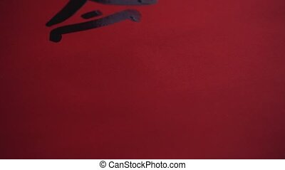 Chinese calligraphy. Writing on red paper.Writing...