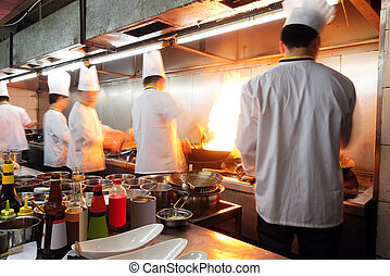 Chinese chef - Crowded kitchen, a narrow aisle, working...