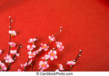 Chinese cherry blossom with red background.