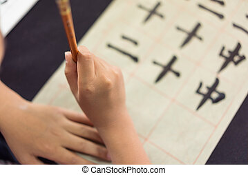 Chinese children learn to write Chinese characters, calligraphy is the traditional culture of China