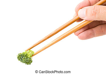 Chinese chopsticks with broccoli.