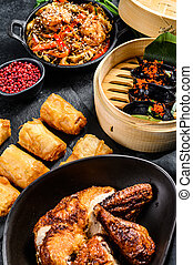 Chinese cuisine dishes set, food black background. Chinese noodles, dumplings, peking duck, dim sum, spring rolls. Famous. Top view